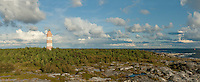 Isokari Lighthouse panorama with mixed clouds scudding by in Southwestern Finland.