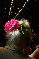 NEW YORK--SEP 13 A woman wearing a silk flower in her hair attends the designer Anna Sui fashion show at Bryant Park during Olympus Fashion Week Spring 2005 in New York City on September 13, 2004. (Photo by Landon Nordeman/Getty Images)