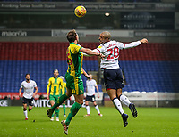 Bolton Wanderers' Josh Magennis competing with West Bromwich Albion's Craig Dawson<br /> <br /> Photographer Andrew Kearns/CameraSport<br /> <br /> The EFL Sky Bet Championship - Bolton Wanderers v West Bromwich Albion - Monday 21st January 2019 - University of Bolton Stadium - Bolton<br /> <br /> World Copyright © 2019 CameraSport. All rights reserved. 43 Linden Ave. Countesthorpe. Leicester. England. LE8 5PG - Tel: +44 (0) 116 277 4147 - admin@camerasport.com - www.camerasport.com