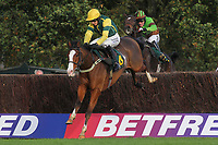 Forgotten Gold ridden by Paddy Brennan jumps ahead of Victor Leudorum ridden by A P McCoy during the October Handicap Chase