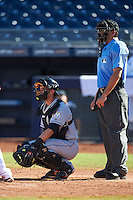 Mesa Solar Sox Austin Nola (8), of the Miami Marlins organization, and umpire Ronnie Teague during a game against the Peoria Javelinas on October 19, 2016 at Peoria Stadium in Peoria, Arizona.  Peoria defeated Mesa 2-1.  (Mike Janes/Four Seam Images)