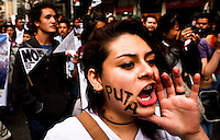 A woman shouts slogans to the government and church while people take part in a march supporting prostitution in Bogota, Colombia. 25/02/2012.  Photo by Eduardo Munoz Alvarez / VIEWpress.