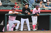 Hickory Crawdads pitching coach Jose Jaimes (20), pitcher Yerry Rodriguez (30) and pitcher Ronny Henriquez (31) stand at the top of the dugout during the game with the Charleston Riverdogs at L.P. Frans Stadium on May 12, 2019 in Hickory, North Carolina.  The Riverdogs defeated the Crawdads 13-5. (Tracy Proffitt/Four Seam Images)