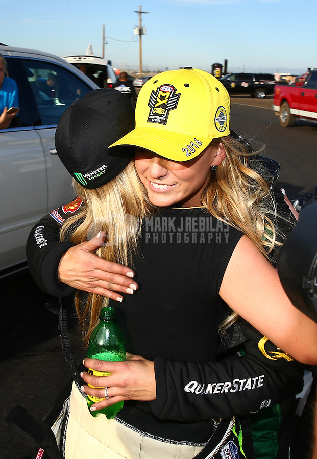 Feb 28, 2016; Chandler, AZ, USA; NHRA top fuel driver Leah Pritchett (right) is congratulated by Brittany Force after winning the Carquest Nationals at Wild Horse Pass Motorsports Park. Mandatory Credit: Mark J. Rebilas-