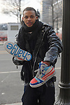 A man with Obama sneakers a day ahead of his historic inauguration as the 44th U.S. President in downtown Washington DC on January 19, 2009.