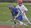 Dylan Pape #3 of West Islip, left, and Mike Gomez #29 of Half Hollow Hills East battle for control of a faceoff during a Suffolk County varsity boys lacrosse game at Half Hollow Hills High School East on Tuesday, May 9, 2017. Hills East rallied from an early 6-2 deficit to win 14-10.