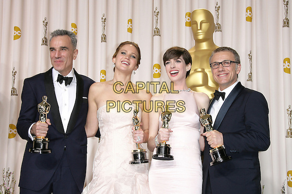 Daniel Day Lewis, Jennifer Lawrence, Anne Hathaway, Christoph Waltz.85th Annual Academy Awards held at the Dolby Theatre at Hollywood & Highland Center, Hollywood, California, USA..February 24th, 2013.pressroom oscars full length black tuxedo bow tie beard facial hair white shirt award trophy trophies winner smiling winners white pink pale strapless dress trophies winners glasses .CAP/ADM.©AdMedia/Capital Pictures.