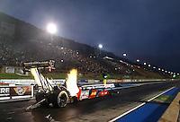 Jul. 18, 2014; Morrison, CO, USA; NHRA top fuel driver J.R. Todd during qualifying for the Mile High Nationals at Bandimere Speedway. Mandatory Credit: Mark J. Rebilas-