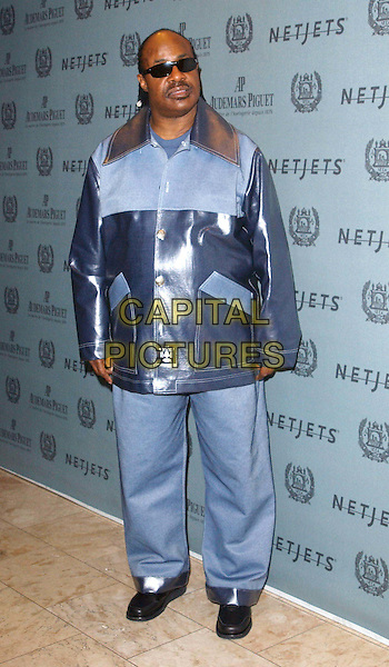 STEVIE WONDER.attends The Time to Give Gala Benefiting the Afghanistan World Foundation held at the St. Regis Hotel in Century City .02/12/03.full length, full-length, blue.www.capitalpictures.com.sales@capitalpictures.com.©Capital Pictures.