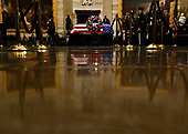 The flag draped casket of former President George H.W. Bush is seen in the Capitol Rotunda in Washington, DC, December 3, 2018. - The body of the late former President George H.W. Bush will travel from Houston to Washington, where he will lie in state at the US Capitol through Wednesday morning. Bush, who died on November 30, will return to Houston for his funeral on Thursday. (Photo by Brendan Smialowski / POOL / AFP)