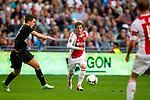 Nederland, Amsterdam, 15 september  2012.Seizoen 2012/2013.Eredivisie.Ajax-RKC 2-0.Lasse Schone van Ajax in actie met de bal...