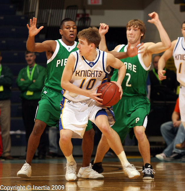 SIOUX FALLS, SD - MARCH 19:  Brent Clark #10 of O'Gorman looks to pass out of a double team of Terelle Walker #3 and Graham Schuetzle #32 of Pierre in the first half of their quarterfinal game at the 2009 Class AA Basketball Championships Thursday evening at the Sioux Falls Arena. (Photo by Dave Eggen/Inertia)