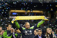Seattle Sounders FC goalkeeper Kasey Keller holds up a golden scarf after a match against the San Jose Earthquakes at CenturyLink Field in Seattle Saturday October 15, 2011. The Sounders FC won the game 2-1. The game was Keller's last regular season home game.