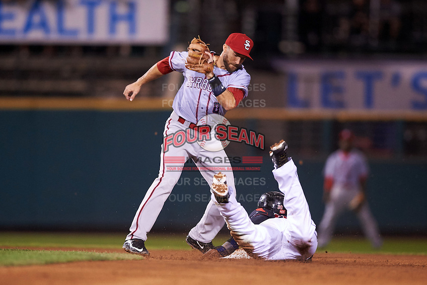 Syracuse Chiefs second baseman Steve Lombardozzi (8) swipes the tag as Adam Walker (30) slides into second during a game against the Rochester Red Wings on July 1, 2016 at Frontier Field in Rochester, New York.  Rochester defeated Syracuse 5-3.  (Mike Janes/Four Seam Images)