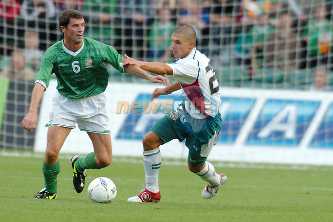 Irelands no 6 Roy Keane holding off Bulgaria's no 20 Valeri Bozhinov during Irelands Friendly international soccer match with Bulgaria in Lansdowne Road, Dublin, Ireland 18/8/04.Photo AFP/NEWSFILE/FRAN CAFFREY..(Photo credit should read FRAN CAFFREY/NEWSFILE/AFP)...This Picture has been sent you under the condtions enclosed by:.Newsfile Ltd..the Studio,.Millmount Abbey,.Drogheda,.Co Meath..Ireland..Tel: +353(0)41-9871240.Fax: +353(0)41-9871260.GSM: +353(0)86-2500958.email: pictures@newsfile.ie.www.newsfile.ie.FTP: 193.120.102.198..This picture is from Fran Caffrey@newsfile.ie