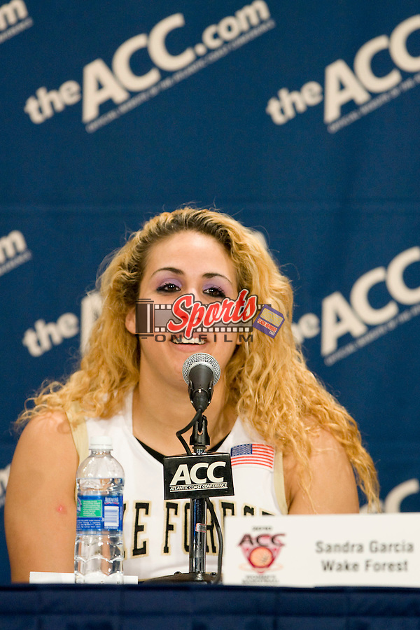 Sandra Garcia #21 of the Wake Forest Demon Deacons answers questions following their win against the Miami Hurricanes in first round of the ACC Women's Basketball Tournament at the Greensboro Coliseum March 4, 2010, in Greensboro, NC.  The Demon Deacons defeated the Hurricanes 66-65 in overtime.  Photo by Brian Westerholt / Sports On Film