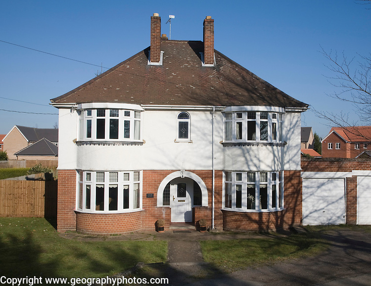Large detached inter-war house with bay windows, Claydon, Suffolk, England