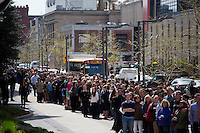 People gather along Vassar Street near the STATA Center on MIT's campus to form a human chain from the site of the killing of MIT Police officer Sean Collier to the headquarters of MIT Police on April 22, 2013. Collier is alleged to have been killed by the Tsarnaev brothers who are accused of detonating bombs at the 2013 Boston Marathon a week earlier.