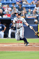 Rome Braves shortstop Marcus Mooney (2) swings at a pitch during a game against the Asheville Tourists at McCormick Field on July 27, 2017 in Asheville, North Carolina. The Braves defeated the Tourists 6-3. (Tony Farlow/Four Seam Images)