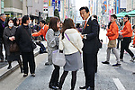 March 7, 2011, Tokyo, Japan - Japanese business entrepreneur Miki Watanabe distributes his cards to passers-by as he takes to the streets of Tokyo following the opening of his election office on Monday, March 7, 2011. Watanabe, the founder of a chain of casual pubs, is running in the Tokyo gubernatorial election April 10, attempting to make the big jump from business manager to big-time politician. (Photo by Masahiro Tsurugi/AFLO) [2910] -mis-