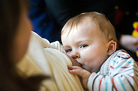 Close-up of a baby breastfeeding at a breastfeeding support drop in centre.<br /> <br /> 01/02/2012<br /> Hampshire, England, UK