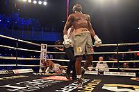 Derrick Osaze (grey shorts) defeats Grant Dennis during Ultimate Boxxer III at Indigo at the O2 London on 10th May 2019