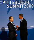 Pittsburgh, PA - September 24, 2009 -- United States President Barack Obama (R) talks with Russian President Dmitry Medvedev while greeting him at the welcoming dinner for G-20 leaders at the Phipps Conservatory on Thursday, September 24, 2009 in Pittsburgh, Pennsylvania. Heads of state from the world's leading economic powers arrived today for the two-day G-20 summit held at the David L. Lawrence Convention Center aimed at promoting economic growth. .Credit: Win McNamee / Pool via CNP