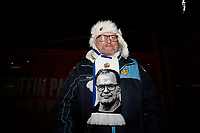 11th February 2020; Griffin Park, London, England; English Championship Football, Brentford FC versus Leeds United; A Leeds United fan poses outside Griffin Park wearing a Leeds United Manager Marcelo Bielsa scarf