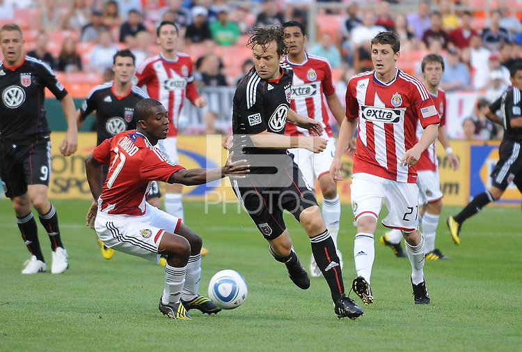 DC United defender Carrey Talley (3) runs with the ball against Chivas USA midfielder Michael Lahoud (11)   DC United defeated Chivas USA 3-2 at RFK Stadium, Saturday  May 29, 2010.