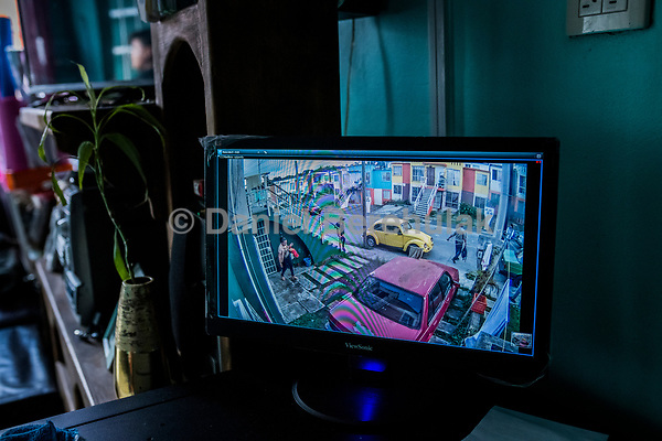 Vicky Delgadillo and Carlos Saldana, are seen on a secuity camera installed in their home, leaving to attend a birthday party and family gathering at Vicky's daughter, Cinthia Hernández Delgadilo, house in Xalapa, Mexico on November 4, 2017. <br /> Photo Daniel Berehulak for The New York Times
