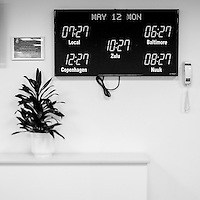 A digital clock on the wall shows date and time in various places at the Thule Air Base. Thule Air Base was established as an American military base in 1951 and is the US Air Force's northernmost base. During the cold War it employed over 10,000 people, mainly serving as a landing and refuelling strip for American bombers, lying halfway between the US and the Soviet Union's industrial heartland via the North Pole. Today, around 550 people work at the base with another 400 Danish and Greenlandic civilian staff.