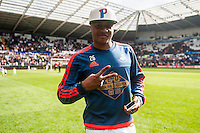 Andre Ayew of Swansea City  on the pitch with team players and staff during a lap of honour after the Barclays Premier League match between Swansea City and Manchester City played at the Liberty Stadium, Swansea on the 15th of May  2016