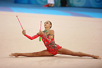 August 23, 2008; Beijing, China; Rhythmic gymnast Evgenia Kanaeva of Russia performs flexibility during clubs routine on way to winning gold in the All-Around final at 2008 Beijing Olympics..(©) Copyright 2008 Tom Theobald
