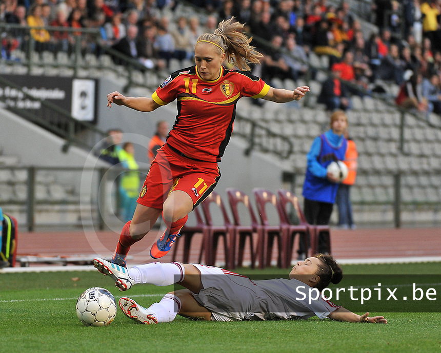 20130921 - BRUSSELS , BELGIUM : Belgian Janice Cayman pictured avoiding the tackling Albanian defender Lulaj Cyme (right) during the female soccer match between Belgium and Albania , on the first matchday in group 5 of the UEFA qualifying round to the FIFA Women World Cup in Canada 2015 at the Koning Boudewijn Stadion , Brussels . Saturday 21th September 2013. PHOTO DAVID CATRY