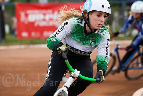 13 SEP 2014 - IPSWICH, GBR - Lauren Hookway from Exeter Aces races out of a bend during the 2014 British Women's Club Cycle Speedway Championships at Whitton Sports & Community Centre in Ipswich, Great Britain (PHOTO COPYRIGHT © 2014 NIGEL FARROW, ALL RIGHTS RESERVED)