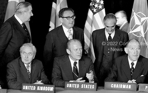 North Atlantic Council Meeting at the level of Heads of State and Government at the North Atlantic Treaty Organization (NATO) headquarters in Brussels, Belgium on May 29, 1975. Front left to right: Prime Minister Harold Wison of the United Kingdom; United States President Gerald R. Ford; NATO Secretary General Joseph Luns. Back left to right: Foreign Minister James Callaghan, United Kingdom; United States Secretary of State Henry Kissinger; Ambassador. P.P. Cedronio, NATO Deputy Secretary General.<br /> Credit: NATO via CNP