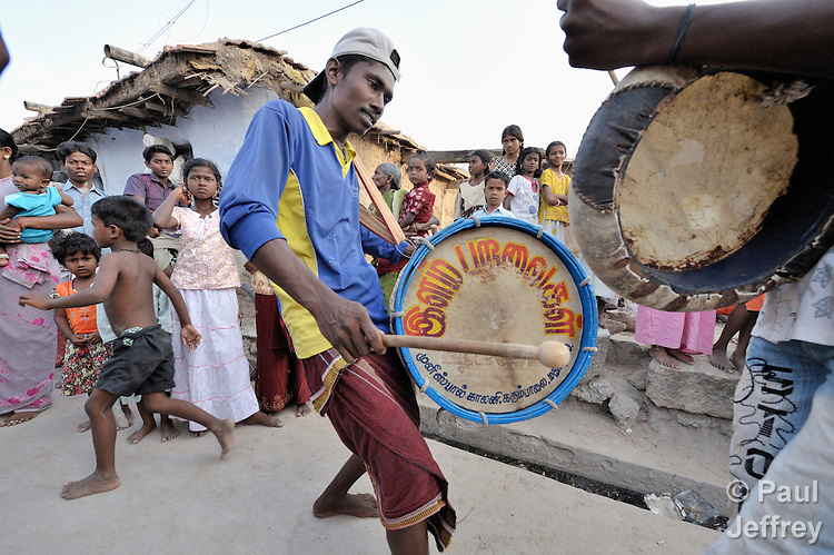Youth play drums to invite residents of Sathangudi, a rural village outside of Madurai in the southern Indian state of Tamil Nadu, to a play about HIV and AIDS. The group is sponsored by the Center for Research and Rehabilitation of Infants and Females (CRIF), which conducts advocacy and education on HIV and AIDS. CRIF receives support from United Methodist Women Mission Giving.