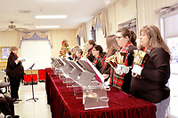 RACHEL DICKERSON/MCDONALD COUNTY PRESS The Anderson First Baptist Church Bell Choir performed at the McDonald County Living Center on Sunday.
