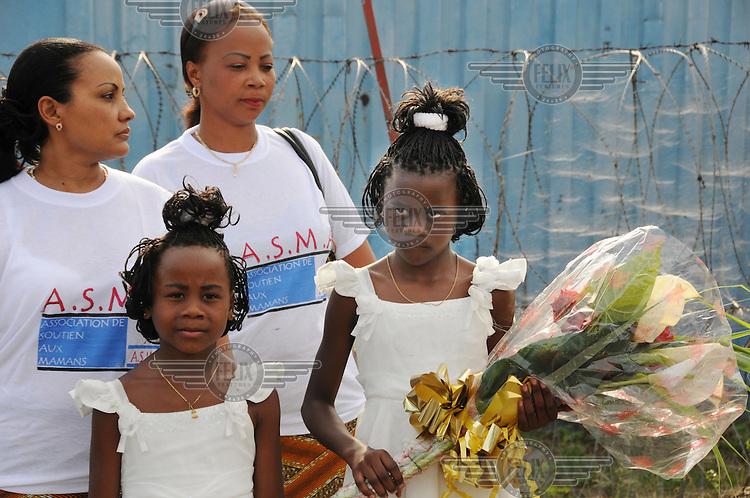 Girls wait to present flowers to President Joseph Kabila on his visit to Goma.