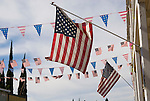 US flags flutter over Main Street by the Hotel Leger for Independence Day in the California Mother Lode town of Mokelumne Hill
