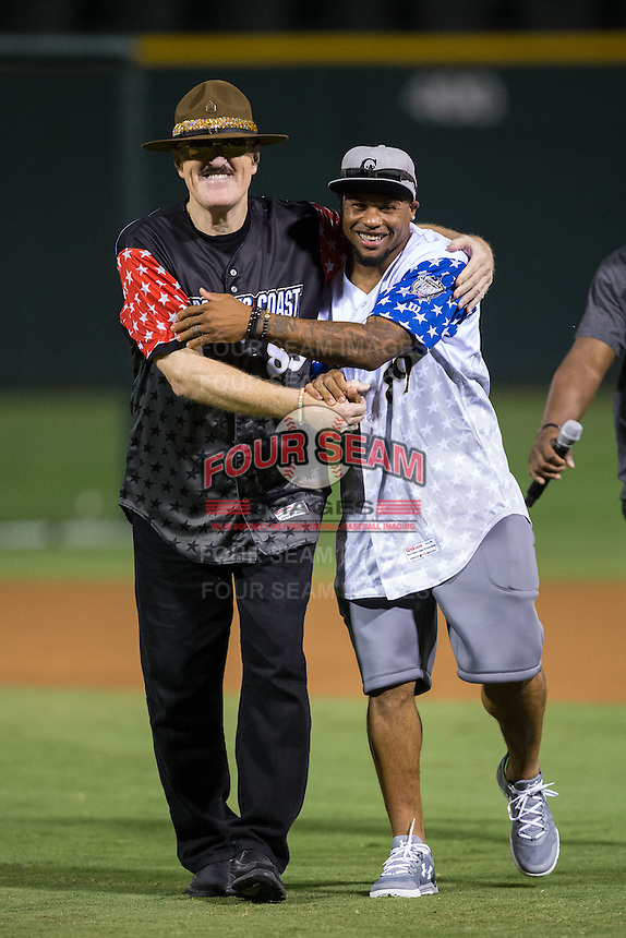 Sergeant Slaughter (left), celebrity coach for Kyle Jensen of the Reno Aces (not pictured), and Steve Smith Sr. (right), celebrity coach for Chris Marrero of the Pawtucket Red Sox (not pictured) hug prior to the start of the final round of the 29th Annual Triple-A Home Run Derby at BB&T BallPark on July 11, 2016 in Charlotte, North Carolina.  Sergeant Slaughter   (Brian Westerholt/Four Seam Images)