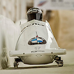 8 January 2016: Nikita Zakharov, piloting his 2-man bobsled for Russia, enters the Chicane straightaway on his second run, ending the day with a combined 2-run time of 1:52.16 and earning a 16th place finish at the BMW IBSF World Cup Championships at the Olympic Sports Track in Lake Placid, New York, USA. Mandatory Credit: Ed Wolfstein Photo *** RAW (NEF) Image File Available ***