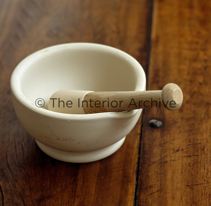A pestle and mortar on an antique wooden table