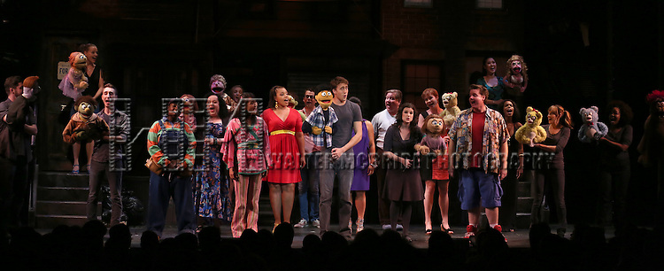 "Jason Jacoby, Danielle K. Thomas,  Sala Iwamatsu, Carmen Ruby Floyd, Darren Bluestone, Veronica J. Kuehn, Nicholas Kohn and Trista Dollison with the cast during the 10th Anniversary Performance Presentation and Curtain Call for  ""Avenue Q"" at The World Stages Theatre on July 31, 2013 in New York City."
