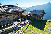 Getting ready at the Cabane d'Essertze for day 2 of the Via Valais, a multi-day trail running tour connecting Verbier with Zermatt, Switzerland.