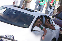 Mexican fans in a car swear and yell at United States fans who were placed on a Mexican police transport bus leaving Azteca Stadium under a police escort. Mexican police officers in riot gear separated the team's fan supporters to prevent any violence and fearing for the fan's safety, Mexican police transported the United States fans to a different subway stop to travel back to their hotels. The United States Men's National Team played Mexico in a CONCACAF World Cup Qualifier match at Azteca Stadium in, Mexico City, Mexico on Wednesday, August 12, 2009.