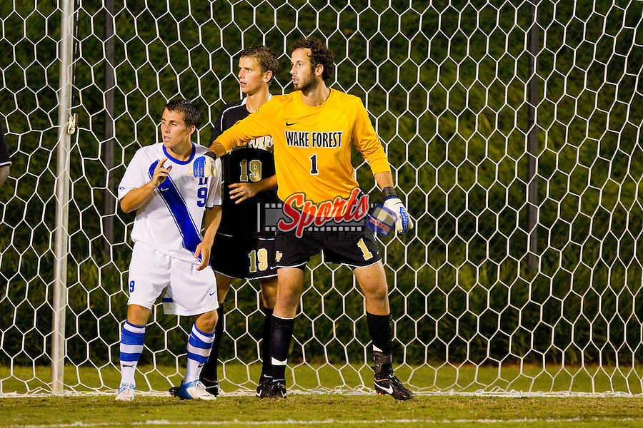Riley Wolfe (9) of the Duke Blue Devils gets into position in front of Collin Martin (19) and Michael Lisch (1) of the Wake Forest Demon Deacons at Spry Soccer Stadium on September 21, 2012 in Winston-Salem, North Carolina.  The Demon Deacons and the Blue Devils battled to a 0-0 tie in 2 overtimes.  (Brian Westerholt/Sports On Film)