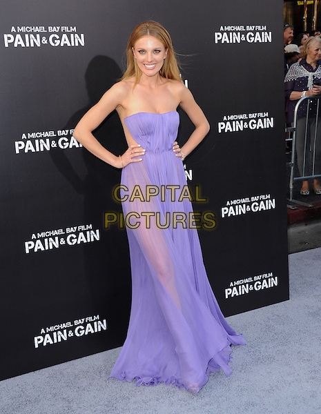 "Bar Paly.The L.A. Premiere of ""Pain & Gain"" held at The TCL Chinese Theatre in Hollywood, California, USA..April 22nd, 2013      .full length dress hands on hips sheer see through thru purple strapless.CAP/RKE/DVS.©DVS/RockinExposures/Capital Pictures."