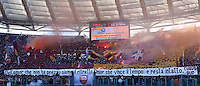 Calcio, Serie A: Lazio vs Roma. Roma, stadio Olimpico, 9 febbraio 2014.<br /> AS Roma fans wave flags prior to the start of the Italian Serie A football match between Lazio and AS Roma at Rome's Olympic stadium, 9 February 2014.<br /> UPDATE IMAGES PRESS/Riccardo De Luca