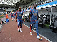 Pictured L-R: Andre Ayew and Bafetimbi Gomis of Swansea arrive Sunday 30 August 2015<br /> Re: Premier League, Swansea v Manchester United at the Liberty Stadium, Swansea, UK